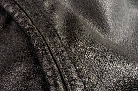 Old vintage genuine soft black leather texture background, top layer with pores and scratches, macro Stock Photo