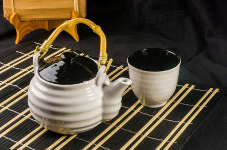 Traditional tea accessories on a bamboo Mat, close-up