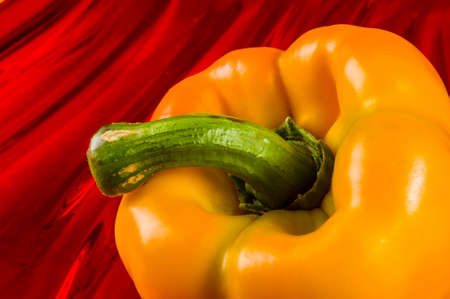 a colorful mix of the freshest red and yellow paprika, bell pepper on red background, close up