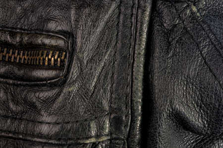 Old vintage genuine soft black leather texture background, top layer with pores and scratches, macro Stockfoto