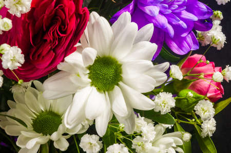 Background for a greeting card - beautiful gift bouquet of various blooming bright colorful decorative summer flowers
