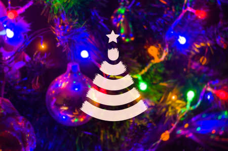 Christmas background-garlands with colorful lights on a decorated Christmas tree, bokeh, blurred, close-up