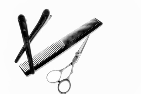 professional haircutting scissors, comb and hair clips Stock Photo - 12791279