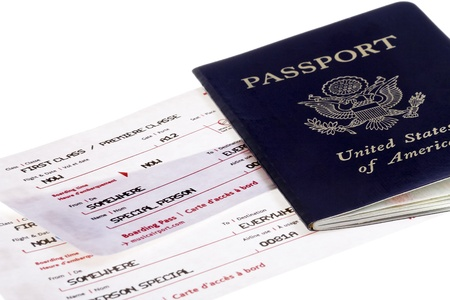 US passport with two special person boarding passes traveling first class photo