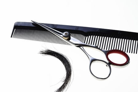 Professional Haircutting scissors with comb and lock of hair photo