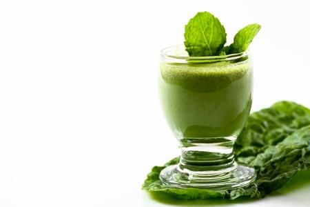 Green vegetable drink with fiber on a kale leaf photo