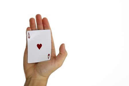 Ace of hearts held in palm photo