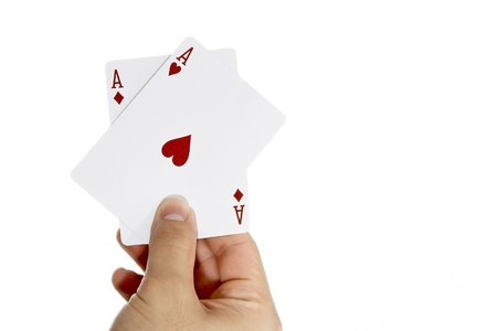 Ace of Hearts and Ace of Diamonds in hand photo