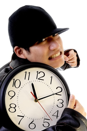 Thief stealing a clock photo