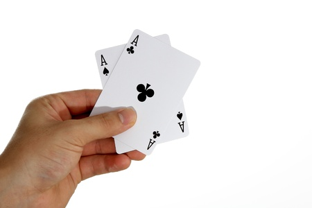 Ace of Spades and Ace of Clubs held in hand photo