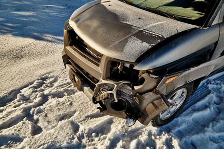 fender: crashed car with deer antler stuck in fender Stock Photo