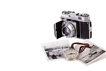 old time: Old 35mm camera with black and white photographs and old time piece Stock Photo