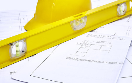 hardhat: A set of blueprints with hardhat and level Stock Photo