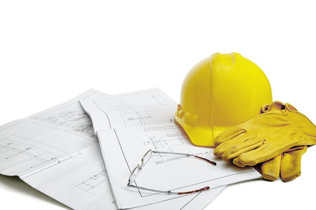 reading glasses: A set of blueprints with hardhat, work gloves and reading glasses isolated on white