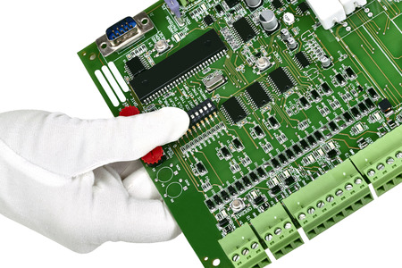 computer repair: A circuit board hand held with white gloved hand isolated on white