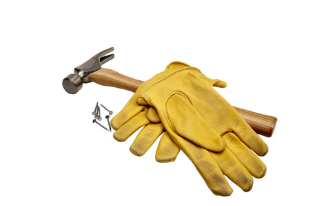 work gloves: Professional studio image of hammer nails and work gloves isolated on white