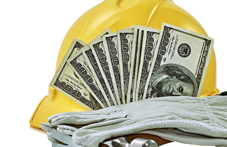 work glove: Yellow hard hat with hundred dollar bills work glove and hammer isolated on white