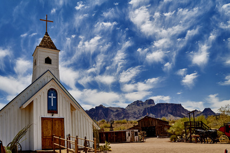 western town: Old church in arizona western town with mountains in background Stock Photo