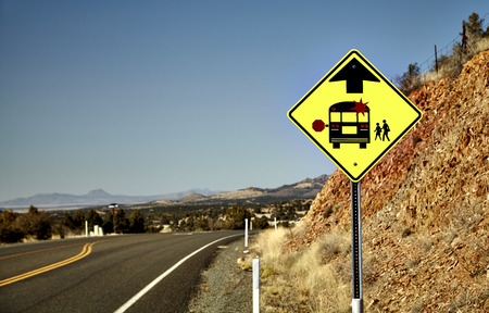 street sign: Road Sign alerting motorists of approaching school bus stop Stock Photo