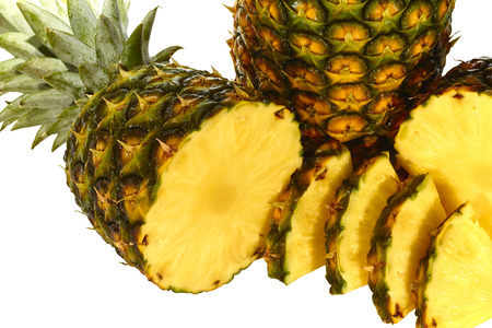pineapple: Pineapple isolated on white with pineapple slices wet and juicy Stock Photo