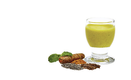chia seed: Tumeric root with smoothie made out of tumeric coconut chia seed flax seed cinnamon and mint isolated on white