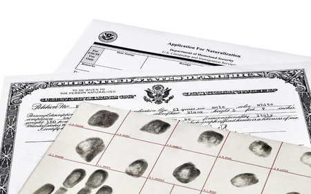 Certificate of Citizenship fingerprint card and application for naturalization isolated on white photo