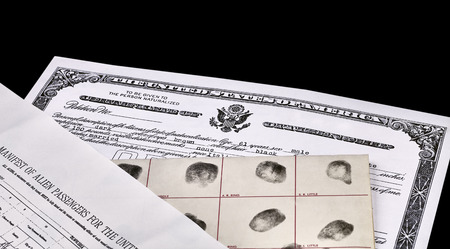 border patrol: Certificate of US Citizenship, fingerprint card, Declaration of Intention and Passenger Manifest documents isolated on white Stock Photo