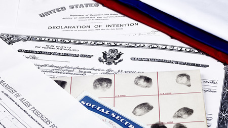illegal alien: Certificate of US Citizenship, social security card, declaration of intention, and passenger manifest with red, white and blue ribbon