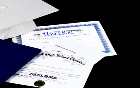baccalaureate: Honor Roll award with high school diploma and commencement ceremony program with graduation cap