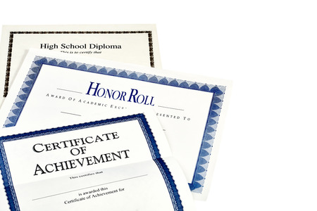 baccalaureate: Education documents including high school diploma, honor roll recognition, and certificate of achievement isolated on white