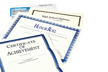 highschool students: Education documents including SAT report, high school diploma, honor roll recognition, commencemnent program and certificate of achievement isolated on black