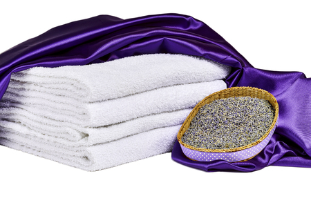 spa towels: Dried lavender flowers in basket with purple satin,  and white spa towels isolated on white Stock Photo