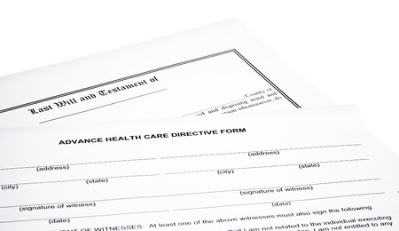 testament: Advance Health Care Directive Form with Last will and testament isolated on white