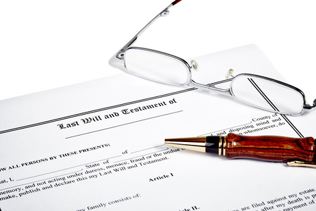 testament: Last will and testament with reading glasses and a wooden pen isolated on white Stock Photo