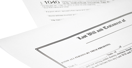 federal tax return: Last will and testament with individual income tax return isolated on white