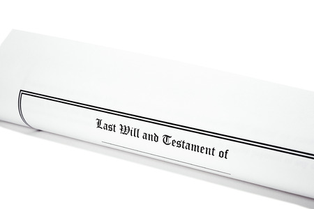 federal tax return: Last Will and Testament rolled up isolated on white