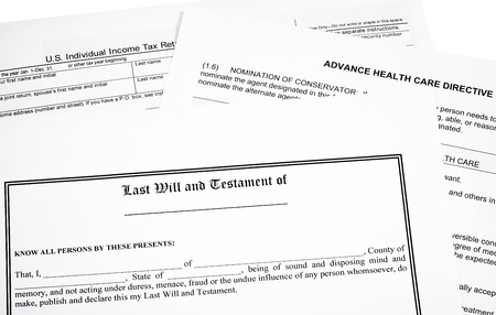 will return: Last will and testament with income tax return  and medical directive form isolated on white