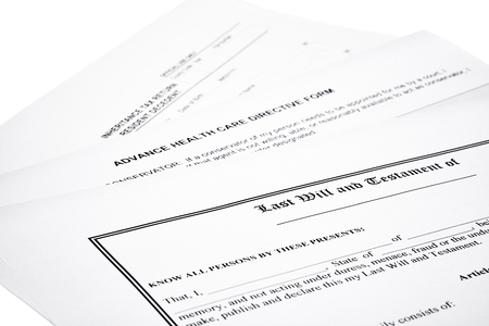 will return: Last will and testament with inheritance tax return  and medical directive form isolated on white