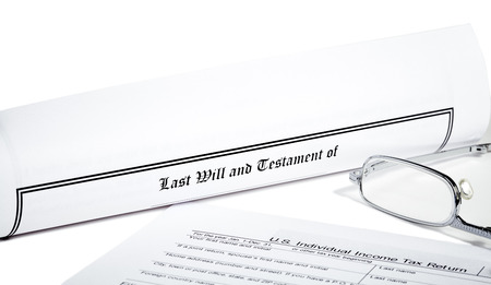 will return: Last Will and Testament rolled up with tax return and reading glasses isolated on white