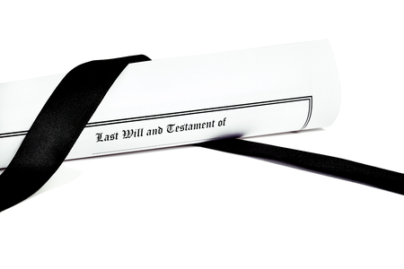 federal tax return: Last Will and Testament rolled up with black ribbon isolated on white