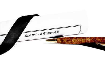 testament: Last Will and Testament rolled up with black ribbon isolated on white with a pen