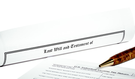 will return: Last Will and Testament rolled up with tax return and pen isolated on white Stock Photo