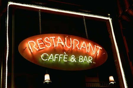 caffe: Neon sign reading Restaurant, caffe and bar hanging window with lights around the window