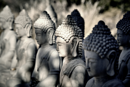 masters of rock: Cement Buddha Statues in a meditating posture