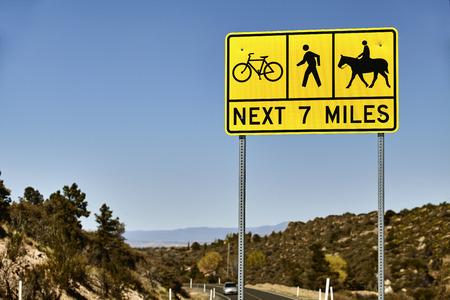 horse pipes: Yellow sign warning motorist of bicyclist, pedestrians and equestrians sharing the road