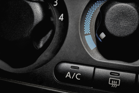 vent: Car dashboard air conditioner switch and vent recirculation button Stock Photo