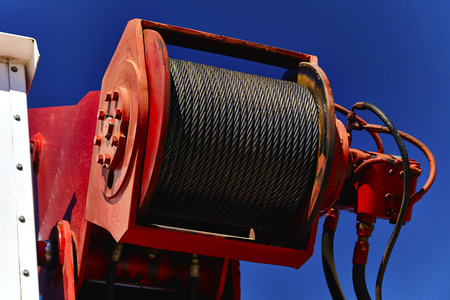 steel cable: Close up of steel cable on a boom crane hoist Stock Photo
