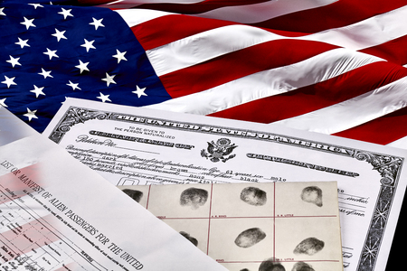 citizenship: Certificate of US Citizenship, fingerprint card, Declaration of Intention and Passenger Manifest documents with US Flag Stock Photo
