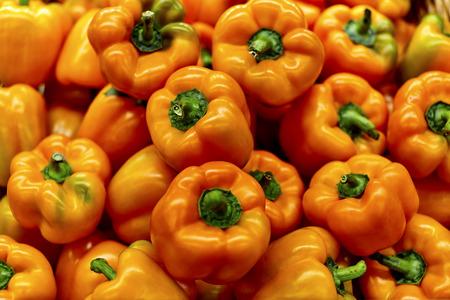 bushel: Bushel full of orange bell peppers