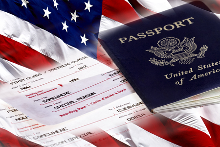first class: United States Passport with First Class Boarding Passes and an American Flag